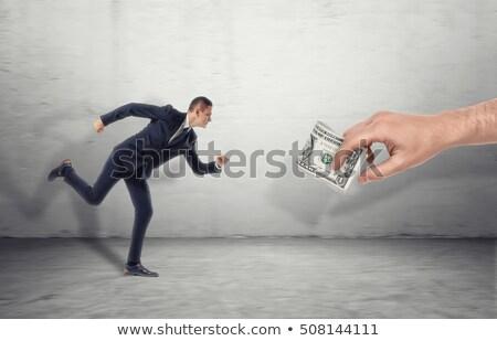 Férfi nyereség formális ruházat zsák pénz pénzügy Stock fotó © ichiosea