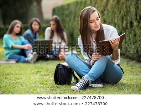 говорить · девушки · мобильных · молодые · улыбающаяся · женщина · мобильного · телефона - Сток-фото © deandrobot