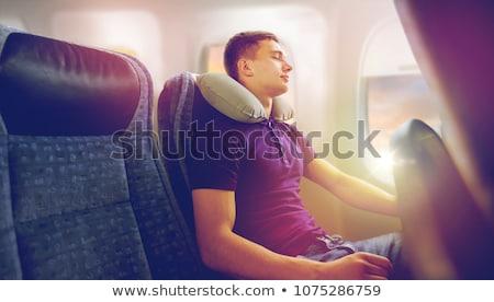 Jonge man slapen vliegtuig reizen kussen toerisme Stockfoto © dolgachov
