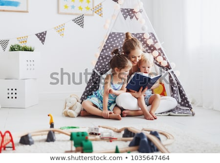 happy little boy reading book in kids tent at home Stock photo © dolgachov