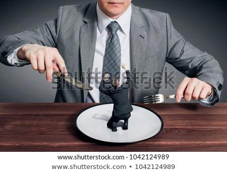 Stock fotó: Nagy · főnök · eszik · kicsi · üzletember · kés