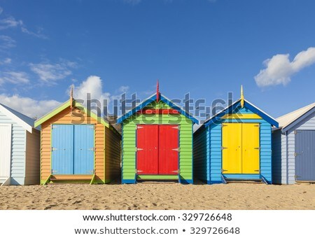 Colorful Beach Huts On The Beach On A Sunny Day Stok fotoğraf © ymgerman