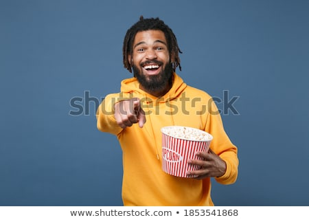 boy in blue hoodie eating popcorn Stock photo © dolgachov