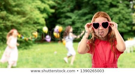 Huncut piros lány szív alakú napszemüveg Stock fotó © dolgachov
