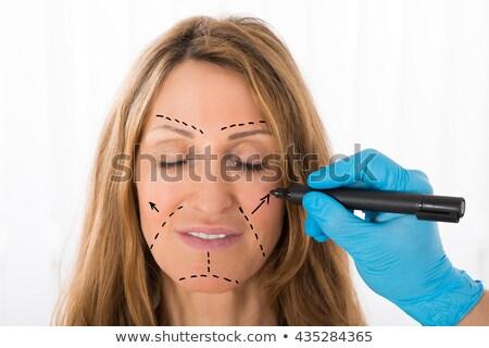 The plastic surgeon preparing for operation on woman hair  Stock photo © Elnur