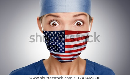 Asian American doctor shocked for COVID-19 crisis help with USA flag on surgical mask. Healthcare wo Stock photo © Maridav
