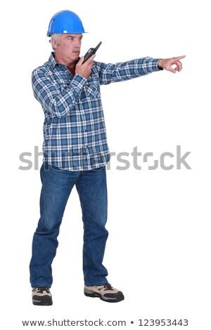Senior foreman pointig whislt speaking into radio Stock photo © photography33