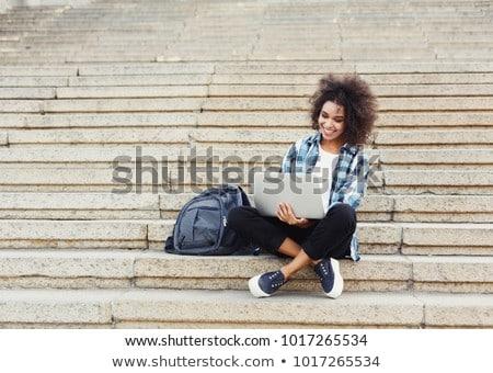 Mutlu Öğrenciler dizüstü bilgisayar kampus üniversite oturma Stok fotoğraf © wavebreak_media