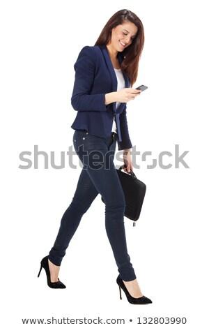 Kadın yürütme ayakta evrak çantası beyaz Stok fotoğraf © wavebreak_media