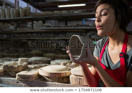 Female potter preparing mug Stock photo © wavebreak_media