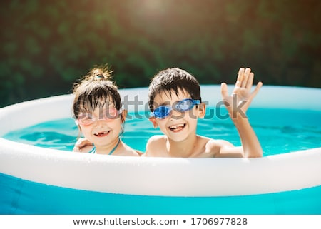 Children in pool wearing swimming goggle Stock photo © IS2