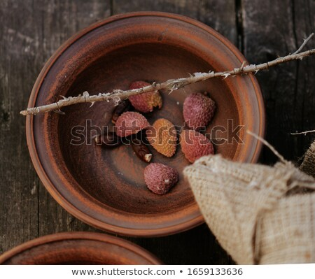 Close-up of the texture of the rind of tropical lychee fruit. Stock photo © artjazz