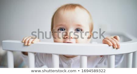 baby girl sit on white sheet Stock photo © Lopolo