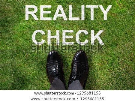 Person Standing Next To Reality Check Text Stock photo © AndreyPopov