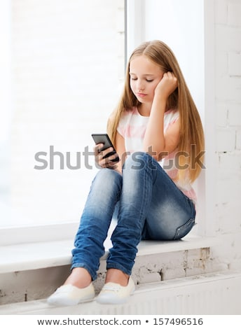 A Unhappy cute Pre teen girl at school Stock photo © Lopolo