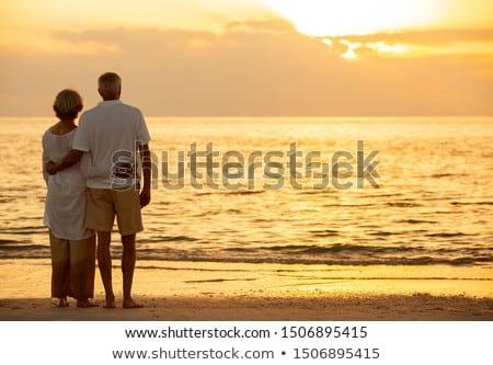 Achteraanzicht permanente strand zonneschijn vrouw Stockfoto © wavebreak_media