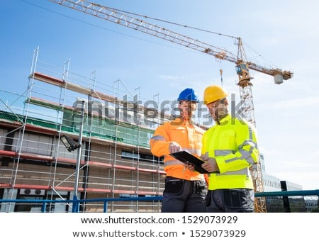 Two Male Engineers Supervising The Construction Site Stock photo © AndreyPopov