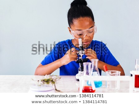 Young student chemist in the classroom  Stock photo © Elnur