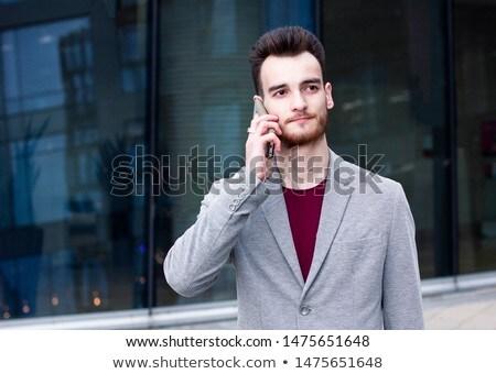 Bello giovani barbuto imprenditore piedi esterna Foto d'archivio © deandrobot