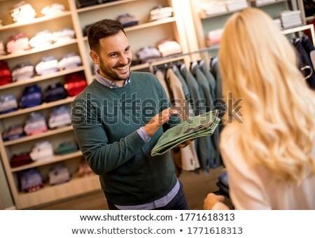 Bonito moço compra calças moda armazenar Foto stock © boggy