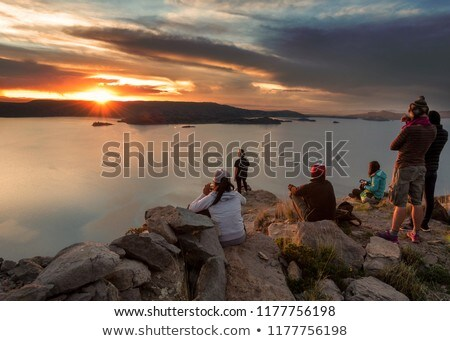 group of travellers with backpacks over sunrise Stock photo © dolgachov