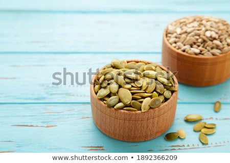 Sunflower Seeds Spilling From a Blue Bowl Stock photo © klsbear
