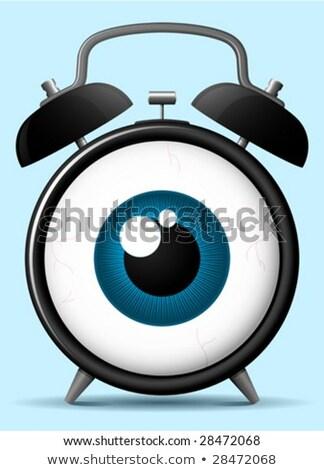 classic alarm clock with staring eyeball stock photo © adrian_n