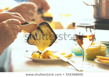 Couple eating raclette Stock photo © photography33
