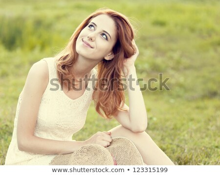 Redhead girl at green grass at village outdoor. Stock photo © Massonforstock