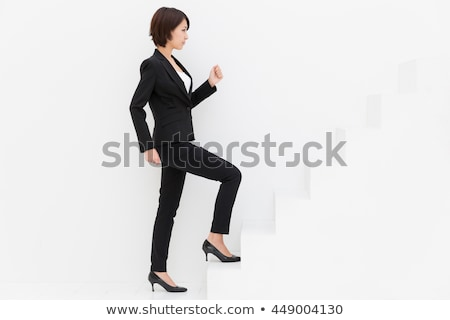 Full legth portrait of asian woman on stairs Stock photo © elwynn