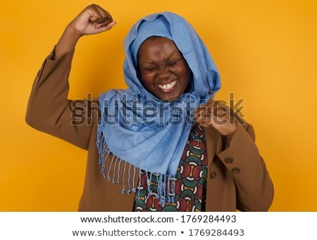Young woman punching the air and smiling Stock photo © bmonteny