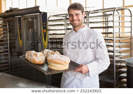 Baker showing tray of fresh bread Stock photo © wavebreak_media