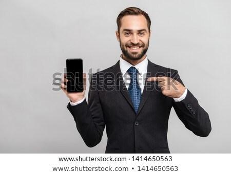 小さな · ビジネスマン · ポインティング · 孤立した · 白 · 背景 - ストックフォト © deandrobot