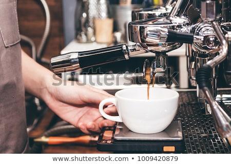 A barista using the coffee machine Stock photo © wavebreak_media