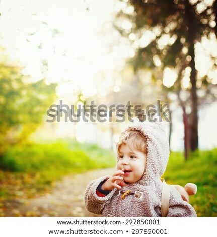 Funny Shy Little 2 year old Boy Giggling in the Park at the Sunset. Happy Childhood Concept. Space f Stock photo © dariazu