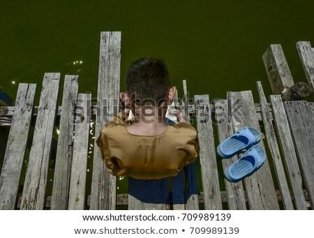 Stock fotó: Fiú · olvas · híd · illusztráció · fű · férfi