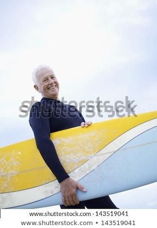 altos · hombre · tabla · de · surf · pie - foto stock © wavebreak_media