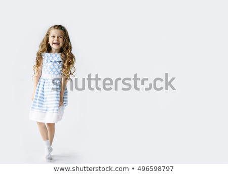 cute little girl in blue dress is laughing  Stock photo © feedough