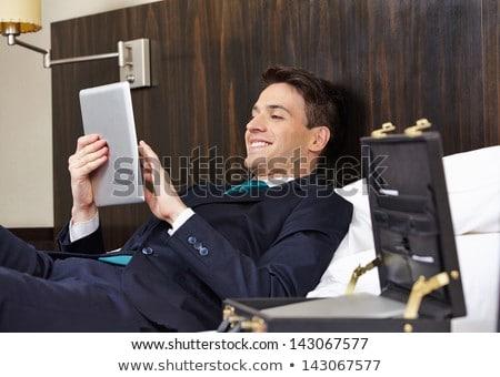 jóképű · boldog · férfi · táblagép · iszik · kávé - stock fotó © tommyandone