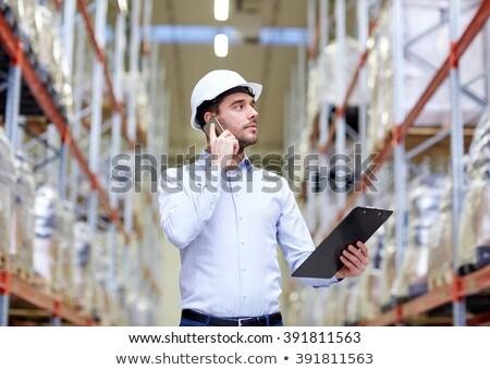 üzletember hív okostelefon raktár nagybani eladás üzlet Stock fotó © dolgachov