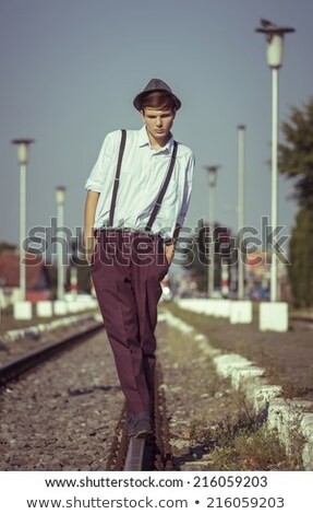 worried guy is thinking while walking with hand in pocket Stock photo © feedough