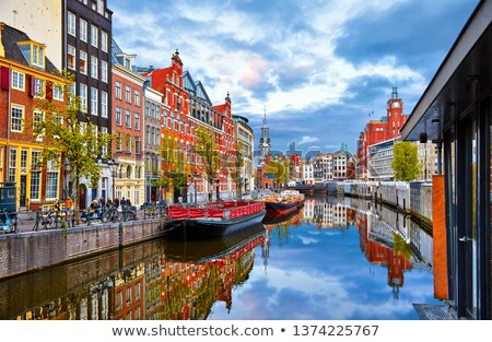 Amsterdam · skyline · panorama · oude · binnenstad · reflectie · gebouw - stockfoto © benkrut