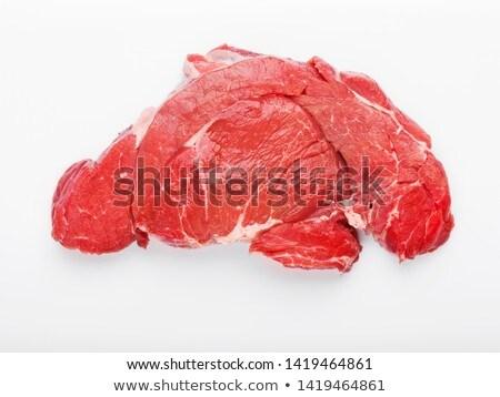 Fresh raw organic slice of braising steak fillet on chopping board with meat hatchet on wooden backg Stock photo © DenisMArt