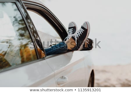 Crossed Woman's Leg Out Of Car Window At Beach Stock photo © AndreyPopov