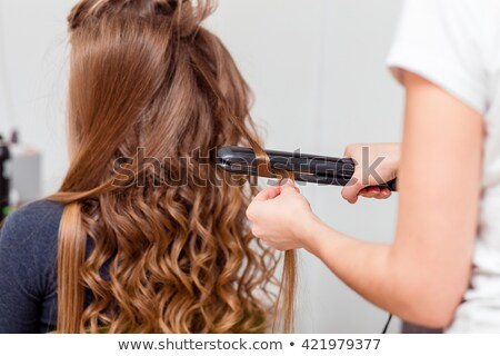 hand holding a curling hair tool. Stock photo © Lopolo