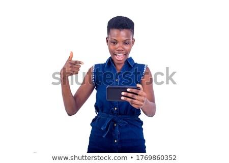 Gelukkig glimlachende vrouw tonen telefoongesprek gebaar vinger Stockfoto © dolgachov