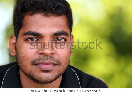 Close up of a handsome young curly haired businessman Stock photo © deandrobot