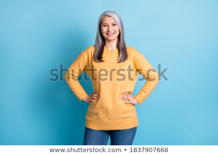 senior woman in blue sweater hands on hips Stock photo © dolgachov