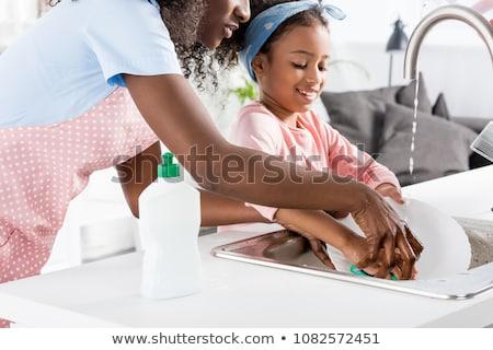 Meisje moeder schotel huishoudelijk werk asian wassen Stockfoto © vichie81
