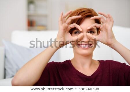 Obraz zabawny młoda kobieta zabawy palce Zdjęcia stock © deandrobot